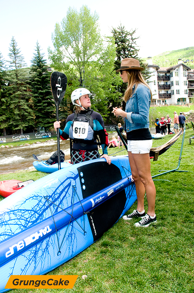 Stacy speaking with Eddie Bauer guide Lel Tone after the stand up paddle boarding event.