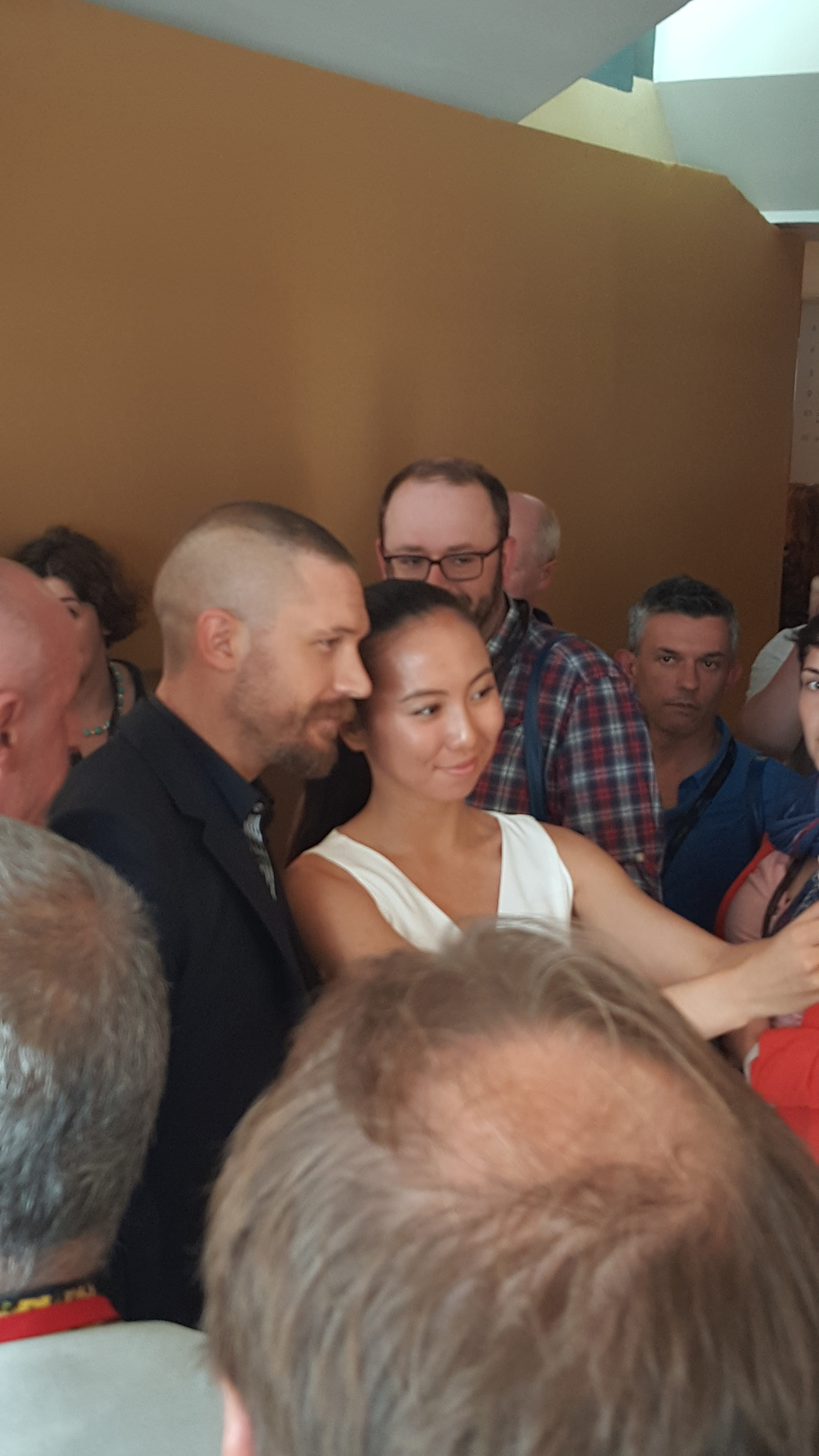 Tom Hardy poses with the press after the Mad Max press conference. (Copyright: Marjolein Keijser)