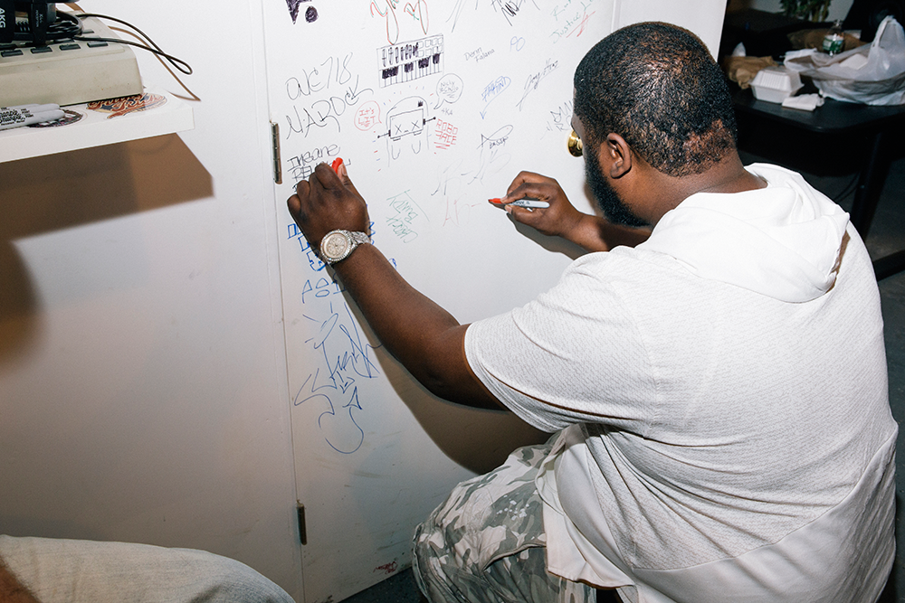 AR-AB signing the door at Roseville Music Group