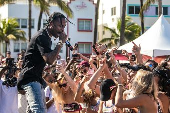 Travis $cott surprises Hawkers Model Volleyball guests (Miami)